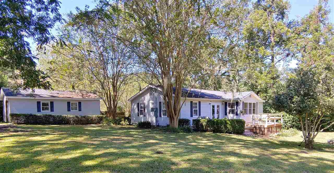 Back up Offers are welcome. Quiet and Charming - Southern Style Cottage - Updated and renovated, newer roof, HVAC, flooring, master suite with beautiful bath and walk-in closets, guest bath and well appointed kitchen - Nice yard with lots of privacy and excellent neighbors - Nice deck and porch.  Walking distance to downtown shops and dining.  Located across the street from the Avera Clarke House BnB and 1 block from the Daffodil House BnB. This home has a 19x20 detached garage and a small storage shed.  There are 3 nut bearing pecan trees on the property.  The home has a small unfinished basement for added storage. Lots of love and care have been put into this home, make it yours today! Call for a showing - must have an appointment.