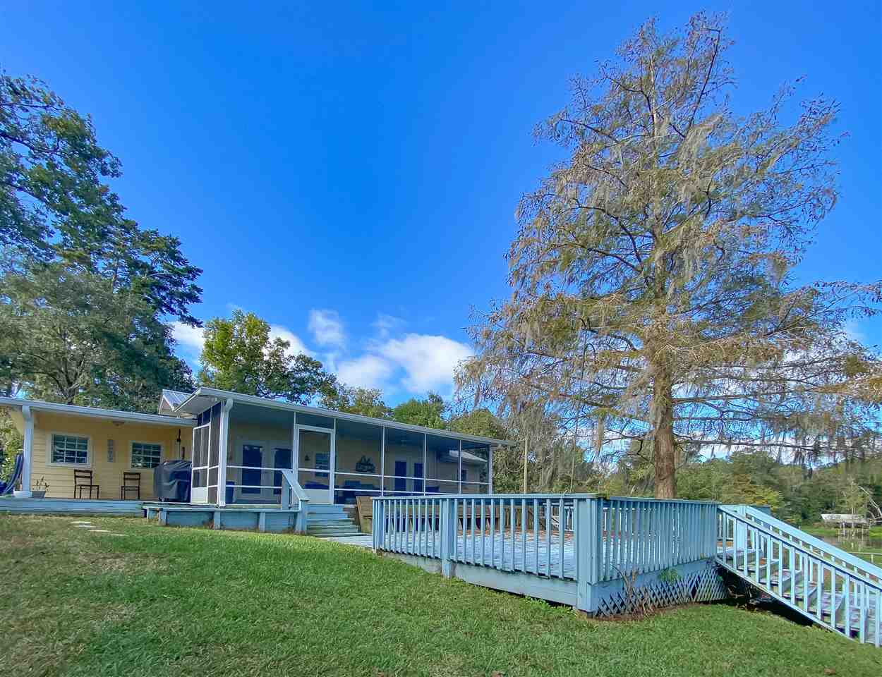 Adorable lakefront cottage available for sale! This wonderfully maintained home will make the perfect getaway, investment opportunity, or retirement home. Featuring an expansive deck and screened in back porch, you will lack no space for entertaining. Enjoy evenings on the dock fishing or relaxing with gorgeous views of Lake Talquin. Boat lift included! This home comes mostly furnished and has fresh paint throughout and new carpet in the bedrooms. Don't miss this great property! Call today!