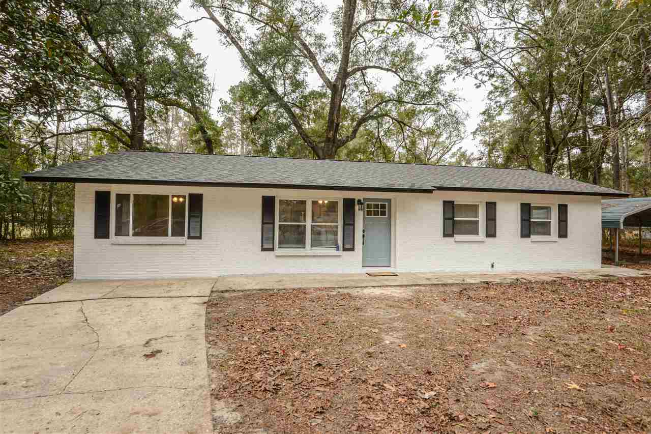 Beautifully updated 3/3 in the heart of downtown Crawfordville. This renovated home has three bedrooms and three full bathrooms and a flex space that could be an office, playroom or bedroom at the back of the home. Updates include a new roof and water heater in 2020, brand new shaker cabinets and granite countertops, new stainless steel appliances. The space has also been painted inside and out, has new laminate floors, new lighting through out and the tubs have been professionally refinished. The home sits on a fully fenced half acre and has a large detatched two car carport. Come see this turn key home today!