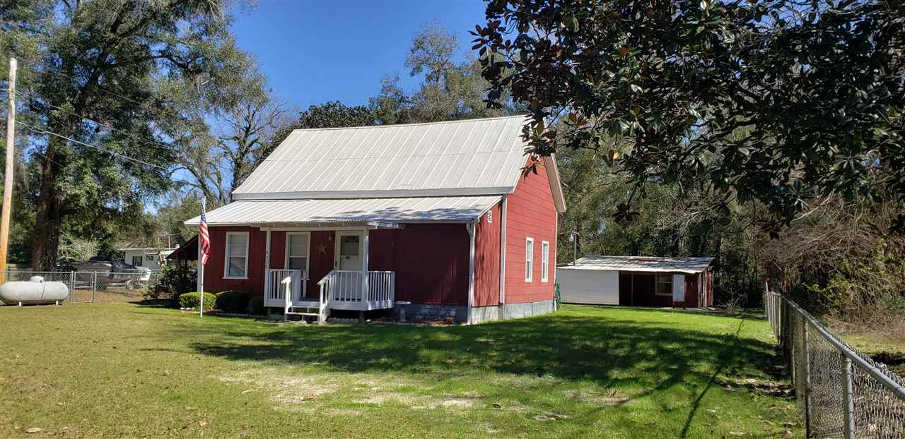 Move in ready, newly remodeled farmhouse style home right off the Woodville Bike Trail! This 1960's home has lots of upgrades including: new septic tank '20, metal roof painted with rubberized paint '20, all new paint inside, upgraded pipes to Pex piping, electrical updated, and new appliances, except stove which is updated. The property is fully fenced, perfect for your kids or pets to play. The outdoor workshop is perfect for the handyman. It has three separate rooms for working and/or organizing your tools and 2 covered parking areas. The screened back porch is perfect for relaxing while staying away from the bugs. There is ample cabinet space and counter top space for the chef in the spacious kitchen which leads into the living area. Spacious bedroom closets allow for ample clothing and storage. Come check out this super cute home today!
