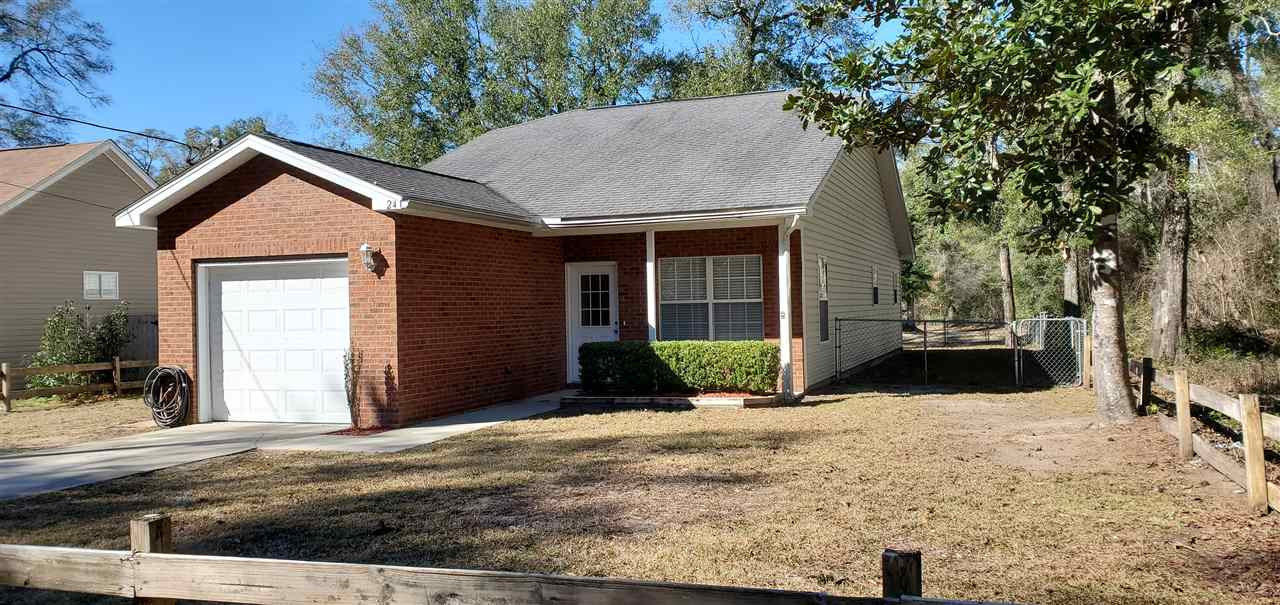 Located in upper Wakulla Gardens, this immaculate move-in ready home is waiting for a new owner!  New paint, new toilets, new cordless safety blinds, new window screens, new ceiling fans, NO CARPET, security system, motion lighting, fenced yard, termite bond, paved road on sewer! What more can you ask for?