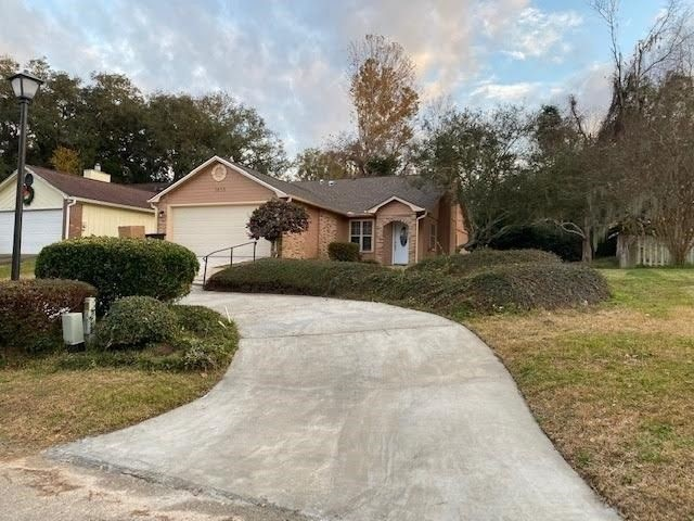 Luxurious and affordable living! Gorgeous bright and clean home in popular Twin Lakes, facing the lake. Totally redone! Move in ready. Just few minutes past Capital Circle on Apalachee Parkway, close to state offices, capitol and universities. Near everything! Perfect for professionals and students! Enjoy beautiful lake frontage view, quiet and relaxing! Vaulted ceilings in the living room. Newer Roof of 2018 and Exterior paint, HVAC 2014. Marble kitchen Countertop with all brand new 2020 stainless appliances, New water Heater, New bath countertops, New Engineered wood flooring of 2020,Fresh paint,New Septic tank updated lighting and fixtures throughout.Marble framed wood-Fireplace. Two car garage and extra parking spot. All you need to call this one home. This is a must see. Professional photos coming soon.Due to Covid19 all parties must wear masks & gloves.