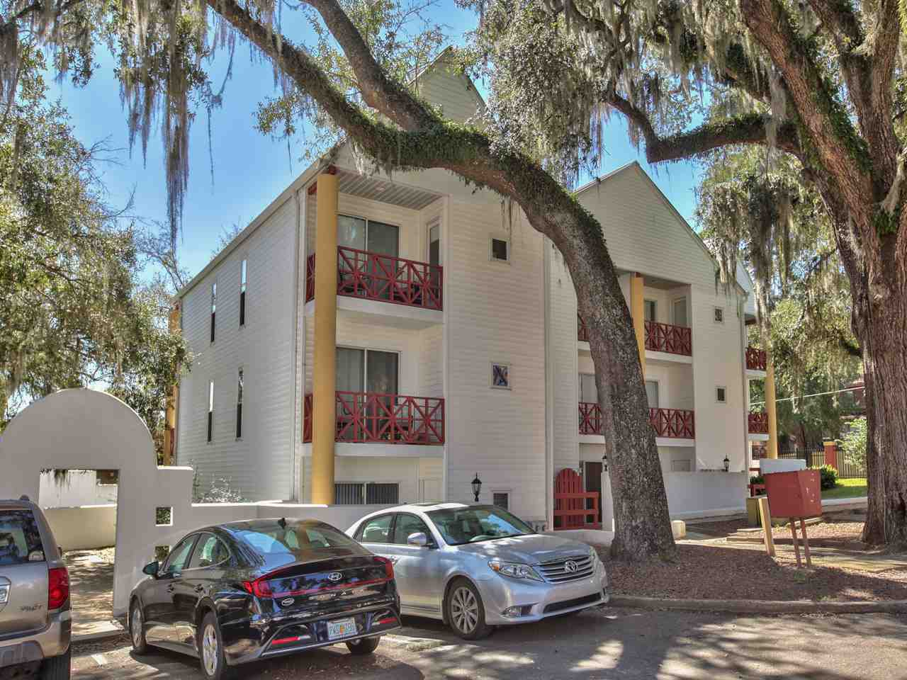 WE HAVE MULTiPLE OFFERS! PLEASE SUBMIT PRIOR TO 5:00 SUNDAY, FEB 28TH.   Appointments made thru LA- leased thru 7/31/21 but can be vacant 5/1/21. Stylish ground floor student condo in highly sought-after complex in the shadow of Doak Stadium! Condos in this complex rarely come available and never last long! Use 2 parking permits or walk to the game, class, bus stops, restaurants, & College Town. Low maintenance, 2 bedrooms, 2 full baths, updated kitchen and baths, freshly painted, covered patios and full-size washer/dryer. HOA fees include exterior bldg and common area maintenance and insurance, trash, water, and sewer. Gorgeous 100-year oak trees adorn this FSU gem. Buyer to verify all measurements. Don't miss out on this INVESTMENT!