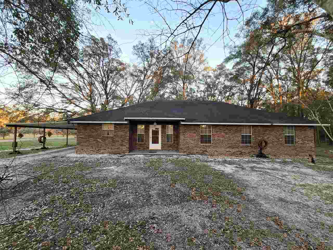 Welcome Home to the peace and quiet of country living. This property is minutes from the Suwannee River, Little River Springs, Royal Springs Park and only 10 minutes from the quaint town of Branford and 30 minutes from Lake City. This well-built, 5 BR 2.5 BA, brick home is nestled on 10 partially wooded acres and is accessible by two entrances. The home features an open kitchen, stainless steel appliances with a breakfast bar overlooking the dining and living room area. Spacious bedrooms, with ample storage, an interior laundry room with a separate entrance, makes this home the perfect space. This home includes a 60 x 60 workshop, with a recreational game space, pool table, bar and full bathroom. Additionally, there is a 10x16 well/pump house and a 10x12 storage shed. This property has a well, large holding tank and water filtration system. The land itself contains cleared areas, for a clean open space around the home and buildings, the back portion has been left in its natural state, creating an excellent place to enjoy the abundant wildlife.  This home is NOT in a flood zone!