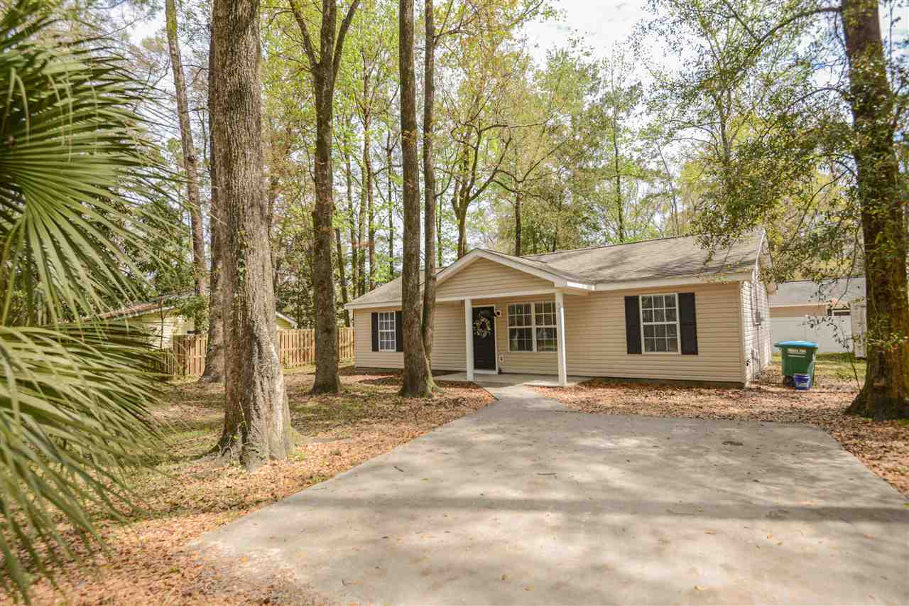 Fully remodeled 3/2 home in the popular Wakulla Gardens! This home is on a double lot and features a split floor plan with vaulted ceilings. This open concept home, with eat-in kitchen, has been redone from top to bottom, including new flooring throughout, granite counter tops, stainless steel appliances and new LED lighting. Additionally, the home has been outfitted with new paint, plumbing fixtures and vanities. A true turn key property, ready for new owners to grow in. Large master bedroom has an en suite bathroom and large walk-in closet. Partially fenced in backyard also has a 6x12 storage shed.  The roof replacement in 2019, new water heater in 2017, septic pump out and new drain field done in 2017 , giving peace of mind for the new owners for years to come!