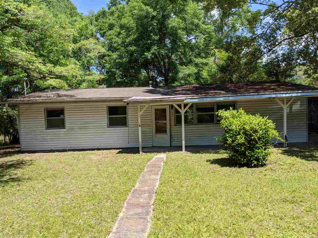 INVESTOR SPECIAL. 2011 Roof, updated electrical, updated plumbing and new cabinets and counters. Great opportunity for a fixer upper in an established neighborhood on .25 acre lot. Seller makes no warranties or guarantees. Sold AS-IS with right to inspect.   Estimated ARV is $130,000
