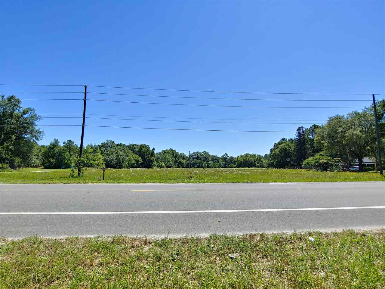 4.29 Acres on desirable North US 221. Beautiful cleared grass acreage. Great for Commercial or Residential.  Zoned Mixed Use - Urban Development, 2 units per acre - Can be subdivided. Not in a Subdivision, No HOA, cleared with some established grass, 30' Easement on South boundary. Lot dimensions are aprox.  Buyer to verify dimensions and land use/zoning. Please notify agent before walking the property.