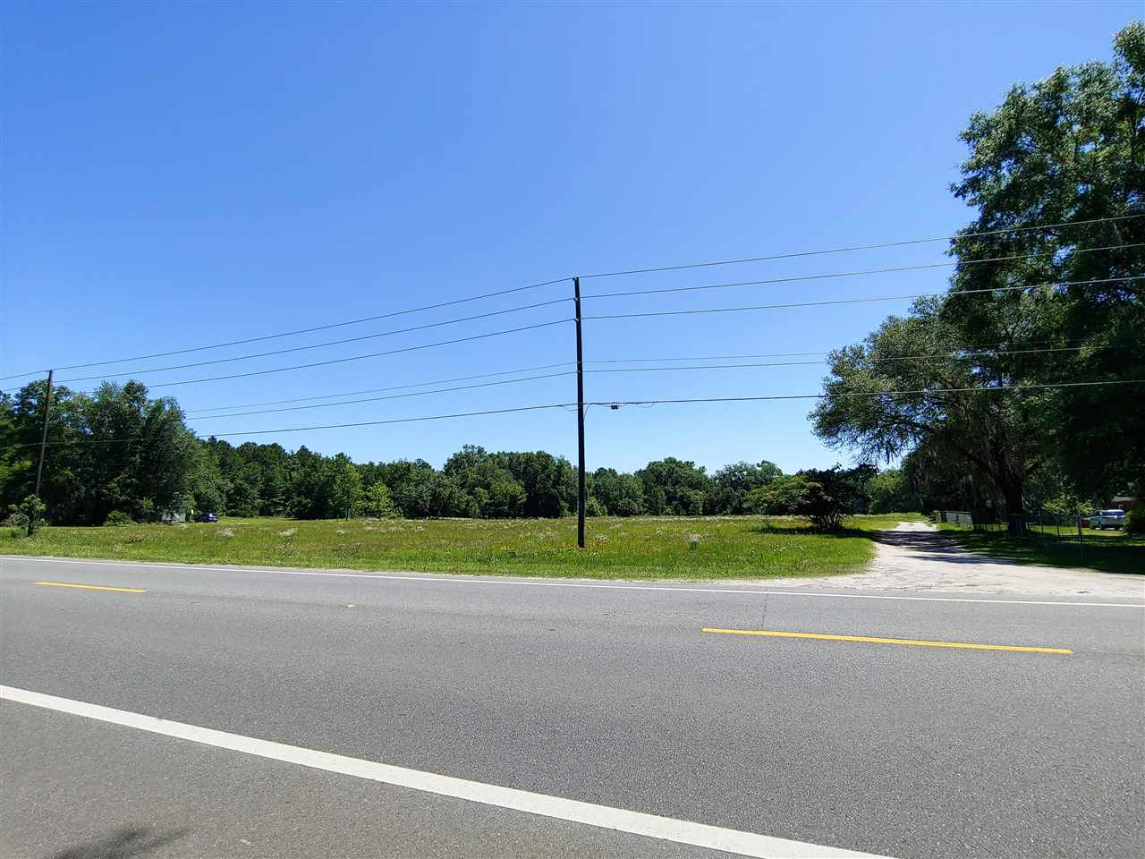 4.29 Acres - 340' N US Hwy 221 Frontage. 631' Deep. 30' Easement on Southern Boundary. All Clear with established grasses.  This property was the Graves Drive-In Theatre and is located next to the Graves Drive-In Restaurant.  Property is Zoned Mixed Use - Urban Development.   2020 Property Taxes are $343.21 - 14.9892 Total Millage.  Please contact agent before walking or driving on the property