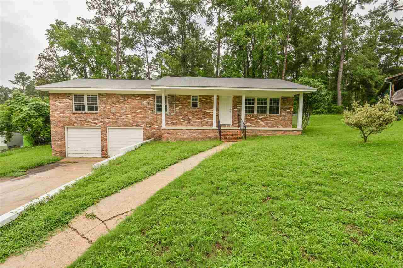 Come check out this all brick home that's close to I-10 in the Lake Jackson area. It even comes with a chicken coop!  The home is located close to many businesses and restaurants. The home has a nice sized, fenced back yard, plenty of room for gardening and kids or pets to play. The hard wood floors have been recently refinished and the home has fresh paint inside. Enjoy cooking in the spacious kitchen that has refinished cabinets and plenty of counter space. Enjoy sitting on your front porch or hanging on the side patio. The home is in great shape and just needs a few touches to make it your own!