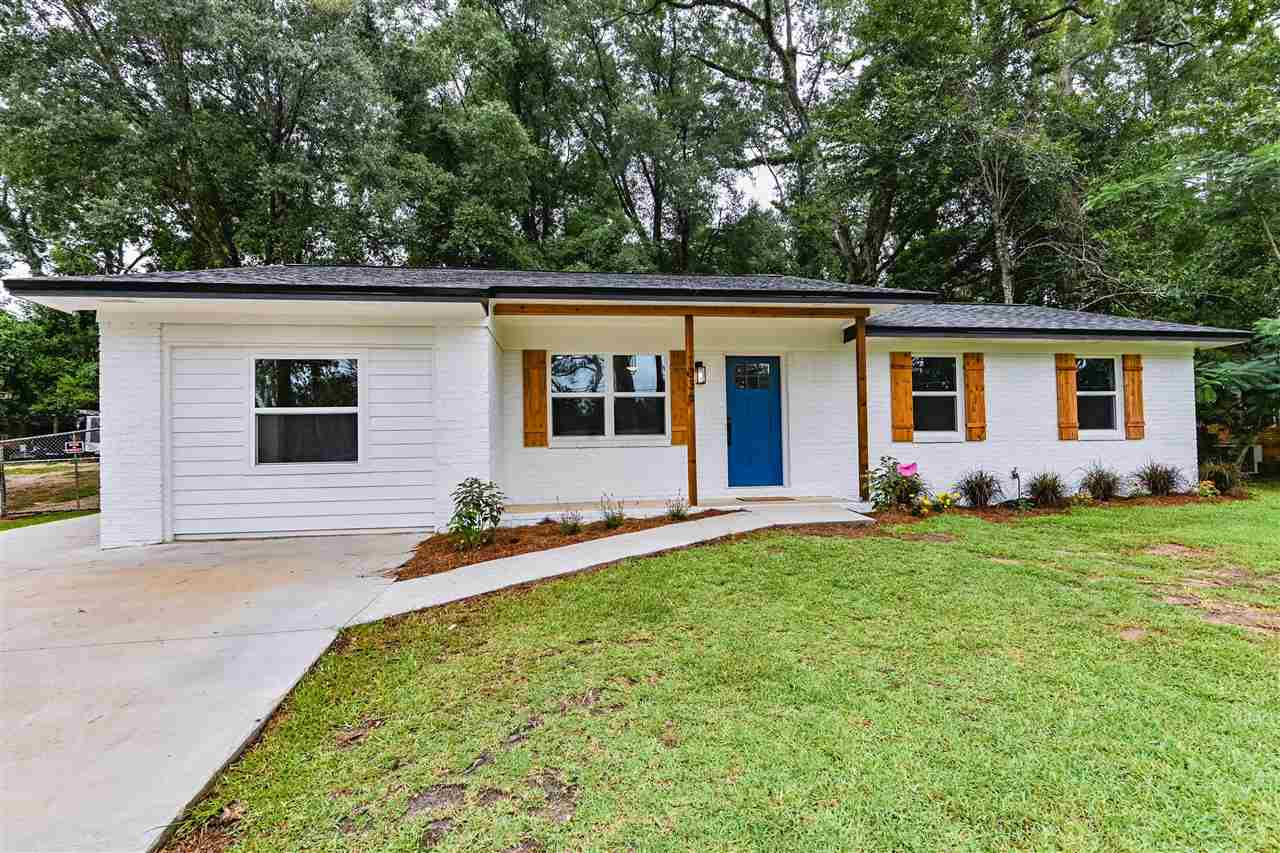 """Stunning remodeled 4/2.5 in popular Indian Head Acres. This home is new from top to bottom. It has been repiped, reroofed, new water heater, new windows, the AC and ducting are new and the driveway was repoured. Highlights of this gorgeous home include solid birch, soft-close cabinets with 42"""" uppers, quartzite counters, stainless steel appliances and a wet bar with beverage cooler beneath. The master bedroom has nine foot ceilings and a rain head shower in the bathroom. The large lot offers a private, fully fenced back yard with a large 16'x16' shed that has electric run to it and was also reroofed. The home has been painted inside and out and has all new LED lighting, LVP flooring and matte black finishes throughout."""