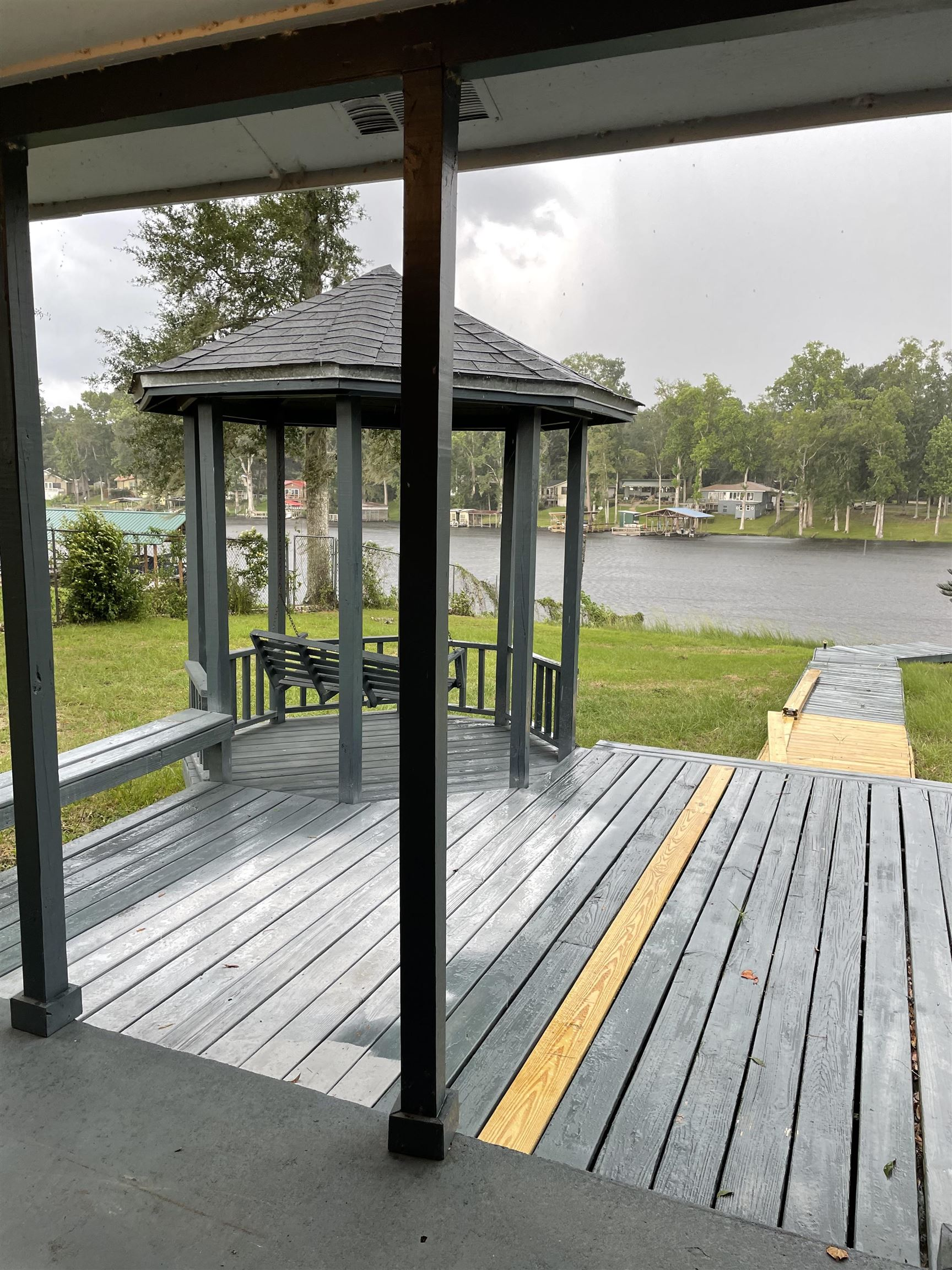 Highly sought after location on Lakefront property off a city paved rd on Lake Talquin, with a dock to keep your boats and a beautiful view from the master bedroom ,Gazebo and deck to enjoy. 150 ft of  Lakefront property on .65 acre lot. Owner will do updates  for the asking price.