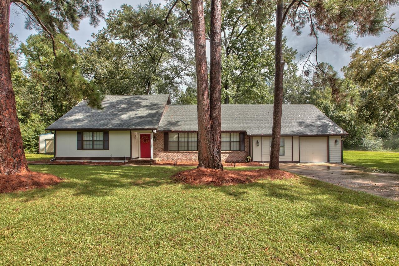 Come discover this gem in historic Monticello; a community rich in nature, culture, great dining, unique retail, local festivals & tournaments, boating, fishing, hunting, hiking and much more. Just 1/2 mile East of downtown is Holly Hill; a neighborhood filled with friendly neighbors walking, strolling and golf carting about. This striking beauty sits on a large treed corner lot and has 4 bedrooms, 3 full baths, a bonus room, breakfast room (cozy fireplace), and a large screened porch. Inside this super-clean, move-in ready home, is a beautiful kitchen, high-end appliances, new lighting, new toilets/faucets, LVP, and carpet in the bedrooms. This home is protected by a 2019 50-yr shingle roof, partial new siding, new exterior paint, clean landscaping, and a termite bond. Buyer to verify measurements. Sold As Is with right to inspect. Won't last long at this price!