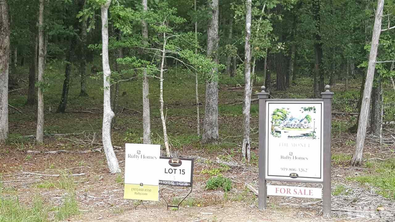 Lot 15 is a stunning 2.61 acre lot sits above the road for added privacy, in addition it has plenty of mature hardwoods throughout the lot for a picturesque country setting. This allows for not only privacy but peace and quiet that you deserve. Custom luxury 4 bedroom lot/home package is available with Rufty Homes. Close to Jean's Berry Patch, Apex Nursery, Southpoint Mall, Jordan Lake, American Tobacco Trail, all Triangle Hospitals, and is convenient to all other points in the Triangle. Low tax Rate!
