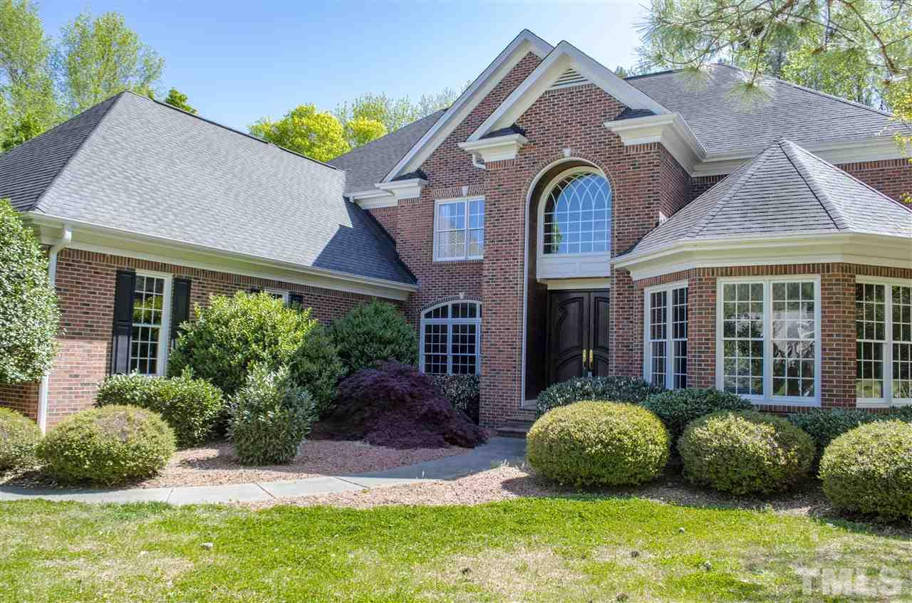 Stately, professional all brick home in gated community.