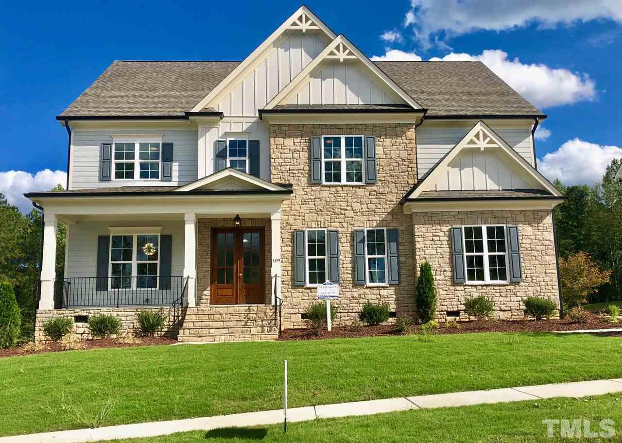 The epitome of true COUNTRY CLUB LIVING comes alive in this BRAND NEW Wardson built showplace. Designer touches and high-end vogue finishes throughout! Kitchen with double-tier cabinetry, farm sink, Pro-style gas rangetop and butlery with wine chiller. Front + Back stairs. MAIN FLOOR GUEST w/ENSUITE. Screen Porch with fireplace overlooks playable backyard. RARE PRIVACY – backs to woods and golf course on a great CUL-DE-SAC street! Quick ZIP to RTP, RDU Intl on 540. SEE THE PICS!