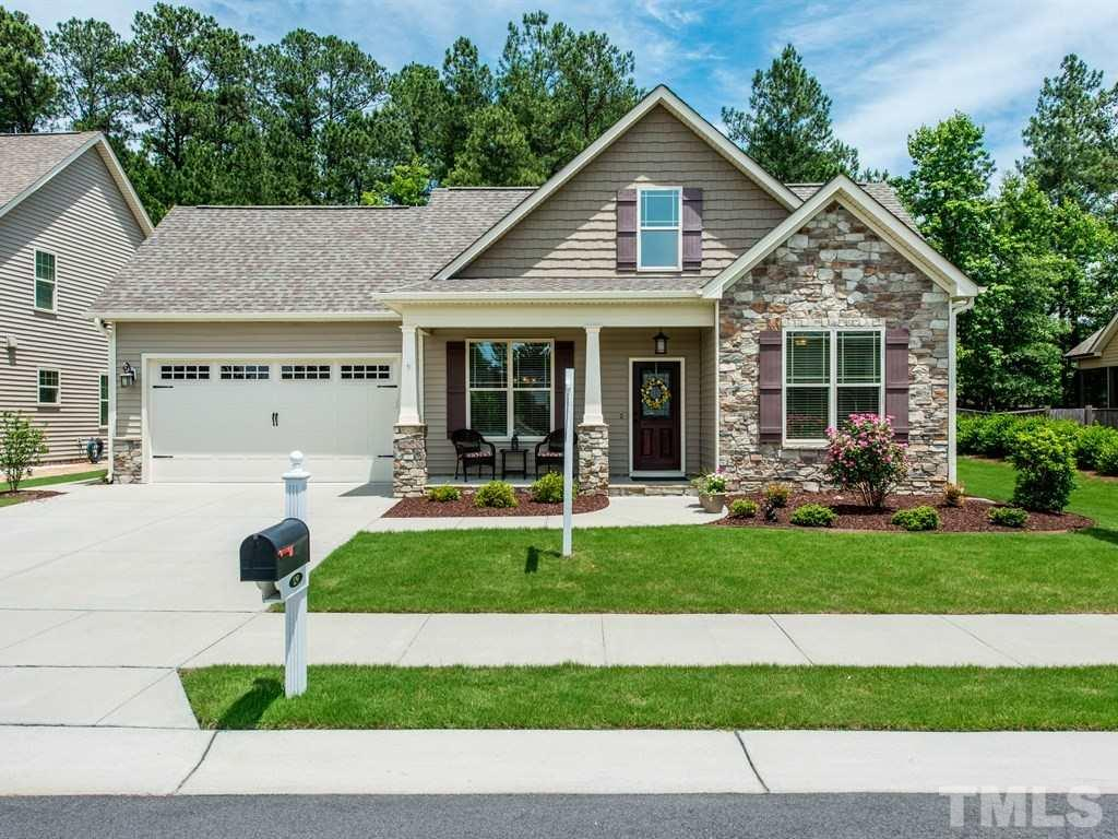 Easy move in & ready to go, you don't have to wait to build! Fabulous one story living with bonus room + full bath + massive walk in closet + walk in storage on 2nd floor! Main floor master + two additional bedrooms! Open flowing floor plan with kitchen open to family room & patio! Flex space with formal dining room! Gourmet kitchen with cream glazed cabinets, quartz counters, seeded glass in butlers area, stainless appliances, the list goes on! Private setting backing to woods! Short walk to pool!