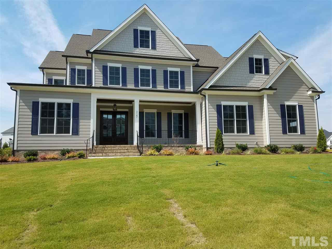 Beautiful custom built home by Legacy Custom Homes.Site finished hardwoods on first floor, stairs, and hall upstairs.  Custom designed kitchen with commercial grade appliances.  kit/breakfast/family all open.  Huge center island with.  Custom shelves and trim work through out.  Dining with coffered ceiling.  Custom closet designs. Free standing tub in owners suite. 10 ft ceilings on first floor.  Over sized 3 car garage, plenty of room for workshop.  Very level home site with great back yard and patio