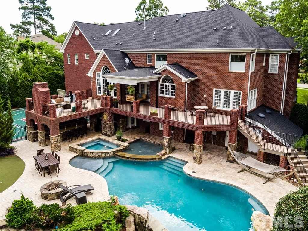 Spectacular Preston Estate Home & ONE OF A KIND OUTDOOR ENTERTAINING PARADISE. Showpiece Golf Course Home - 4 levels, 7,600+SF, 6 BR's, 6.5 Bath, In Law/Teen Suite, Bsmt RecRm, FlexRm, CraftRm, on Highlands #8 Hole. Huge TREX® DECK leads to outdoor brick FP. Travertine patio surrounds custom stone infinity pool, hot tub & fountain/kiddie pool. Feel like GOLF - Grab your putter and enjoy YOUR OWN PUTTING GREEN. Enjoy the ACTIVE LIFE ON YOUR ALL SPORTS COURT! Complete OUTDOOR KITCHEN!PLUS BRAND NEW ROOF!