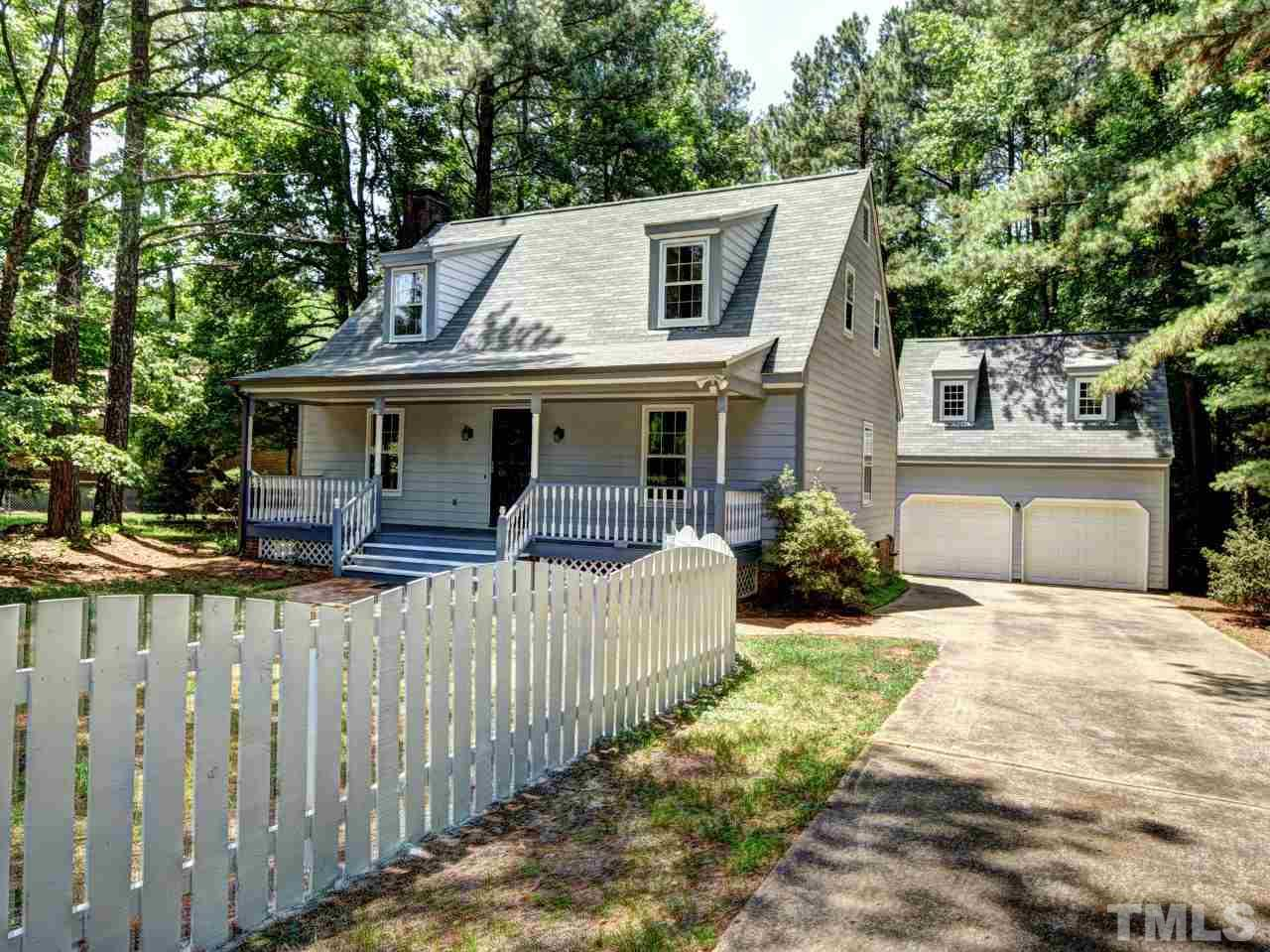 Updated & Well Maintained-Move In Ready! 3 BR 2 1/2 Bath w/HUGE .71 Acre Fully Fenced & Level Lot. Recent updates: Fresh Paint, Roof & Gutters, New Plumbing & Fixtures (PEX), Appliances, Walk-in Master Shower, Septic Pumped & Updated. Detached 2 Story Garage (or Workshop) w/Sep. 100 Amp Service, Screened Porch, Fiber Cement Siding, Rocking Chair Front Porch, Wood Burning/Gas Log Fireplace. NO HOA Fees or City Taxes! Needs New Carpet. Seller Wants Buyer to Choose! Fair Carpet Allowance w/Acceptable Offer.