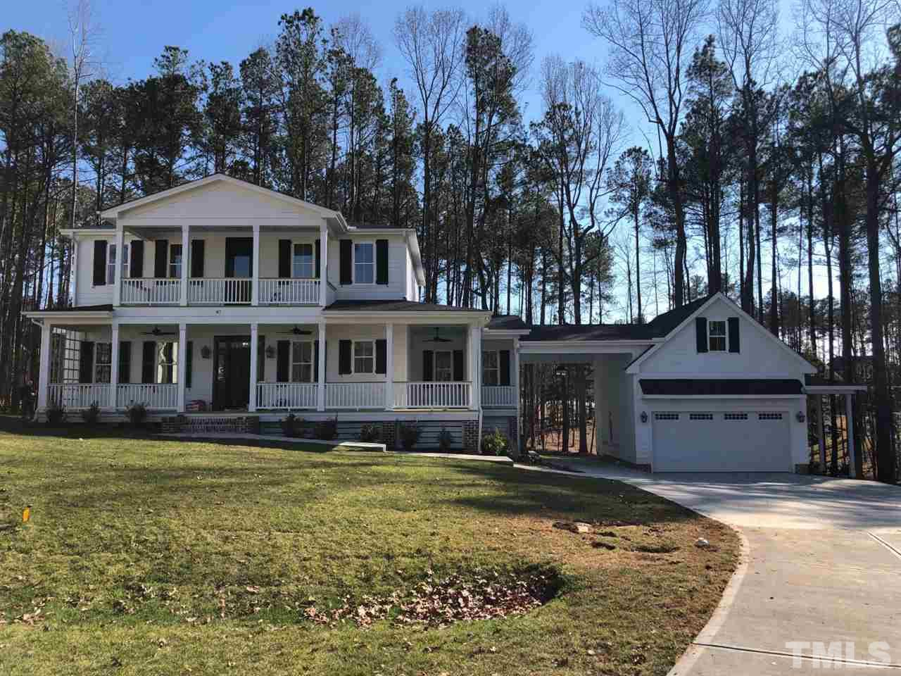 Great Cul De Sac lot in gated community. New Construction home with southern architecture, Covered wrap around porch and 2nd floor centered porch. Detached 2 car garage with rear shop and side shed covered parking, connected to the house by a breezeway.