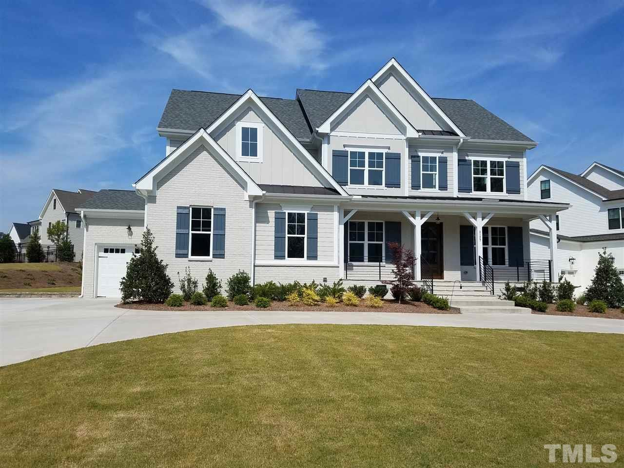 Custom Built home by Gray Line Builders.  Beautiful home with circular drive in front.  Custom cabinets in gourmet kitchen with huge center island, all open to family room and breakfast room.  Custom bookshelves beside fireplace in family and bonus rm.  Custom trim work through out, hardwoods first floor, stairs and hall upstairs.  Two bonus rooms one could work as fitness room.  Spa type owners bath with massive walk-in custom built closet. Circular drive in front