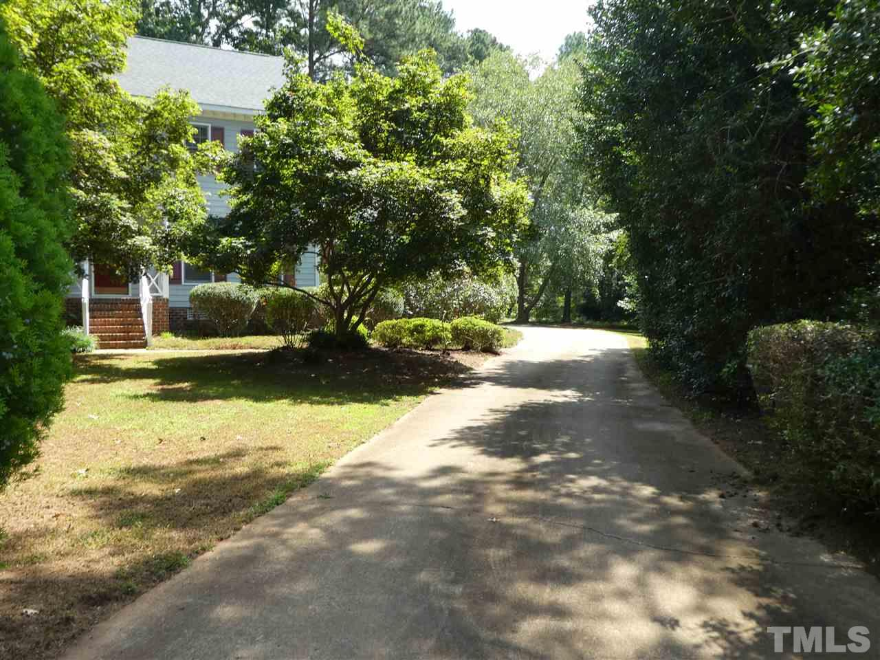 Distinctively remodeled 2-story Lochmere home w/side entry garage on .47 acre private cul-de-sac lot.Updates include granite kitchen counter tops, wet bar, kitchen cabinets w/stained alike glass,SS appliances, new Baths,Jacuzzi tub in hall bath, dual shower head in master bath, hardwood on 1st floor except Living Rm, back stairs to bonus RM, oversized deck w/patio, fresh paint, new carpet. Enjoy Lochmere Swim & Tennis Club, 3 lakes & 10 miles of walking trails.Semi-private golf club.close to everything.