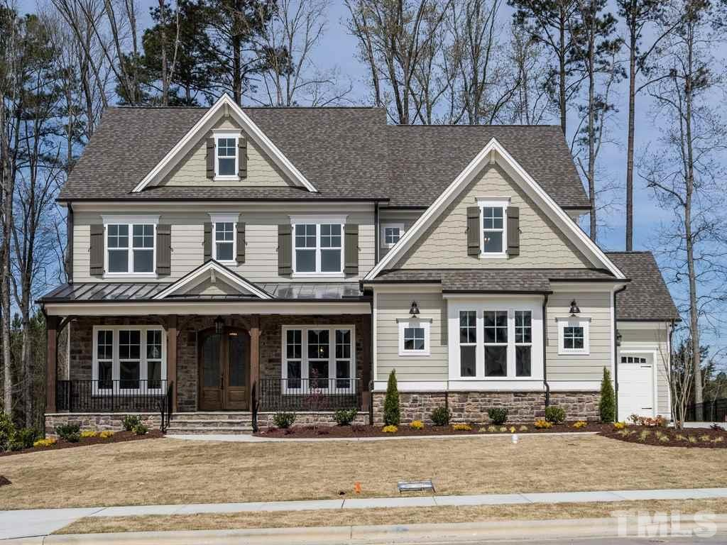 Beautiful custom built home by Future Homes by Jim Thompson.  Premium lot backs up to open space and very level.  Front porch opens to arched double doors.  Large study for home office. Dining room with large niche area.  Gourmet kitchen with cabinets to ceiling opens to large family room and also breakfast area.  Custom built in cabinets either side of fp.  Large screen porch with fireplace.  Bonus room upstairs with custom barn door.  Owners suite with spa bath, free standing tub and to die for closet