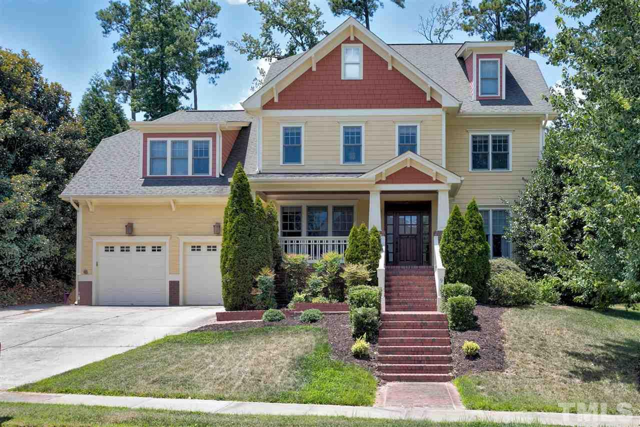 Executive 5 Bed/4.5 Bath home in Cary Park!  Gourmet kitchen w GRANITE,  dbl oven, under cabinet lights, butler's pantry & walk-in pantry. Open concept living: 1st floor office, formal dining, breakfast sunroom, FIRST FLOOR bedroom w FULL bath! Extensive trim, wood flrs, wainscoting, built-ins,. Master w/ trey ceiling, dual vanity, sep jetted tub, tile shower, his/hers closet. Bonus Room on 2nd floor. XL Rec Room on 3rd floor with FULL BATH. Entertain on the CUSTOM outdoor patio w/ fire pit! Close to RTP