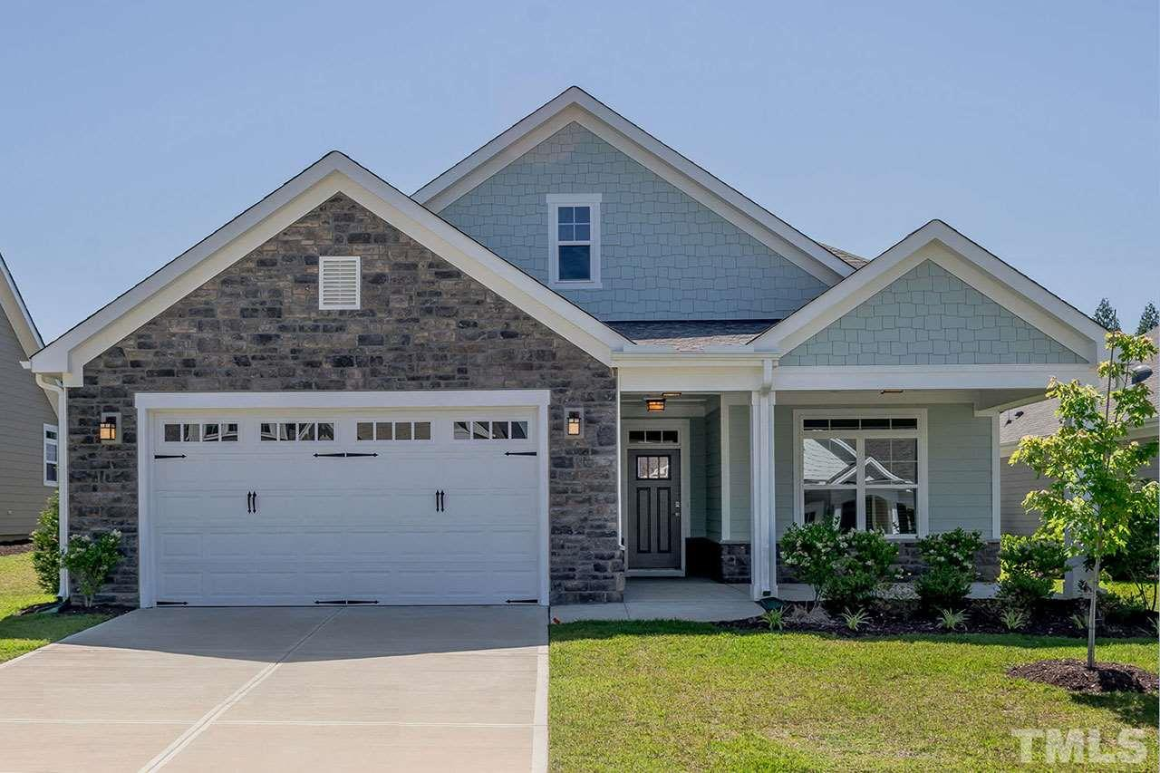 McKee Homes presents the Salerno Bungalow, a beautiful cottage-style home w two bedrooms &three bathrooms. The oversized two-car garage allows for ample storage. The low-maintenance covered porch and courtyard is perfect for entertaining or enjoying warm afternoons. The master bedroom features a large walk-in closet, which connects directly to the laundry room and sitting room.  The Salerno Bungalow includes a second-story bonus suite w full bath.Located in Evergreen at Flowers Plantation a 55+community.