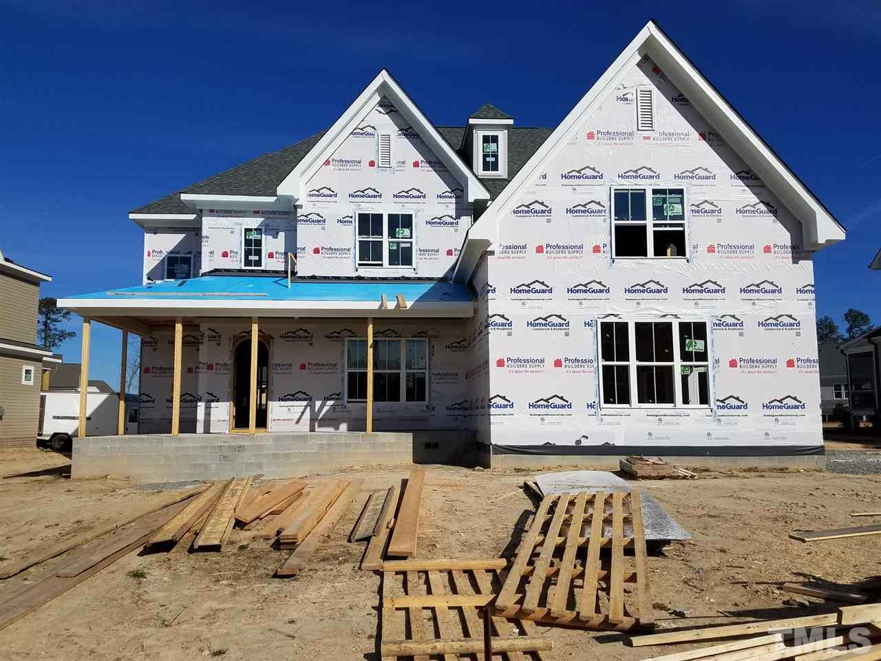 Beautiful custom built home by Gray Line Builders, two story foyer, open kit/family/breakfst area.  Beamed ceiling in Family room.  Huge island in kit, walk in pantry.  Hardwoods 1st floor, stairs and 2nd flr hall. Oversized 3 car garage with plenty of room for work space.  Home office with built in desk off drop zone, cubbies.  Finish third floor flex room for theater/adult bonus/home office with half bath.  Large owners suite with very tall vaulted ceilings and closet with his and her sides.