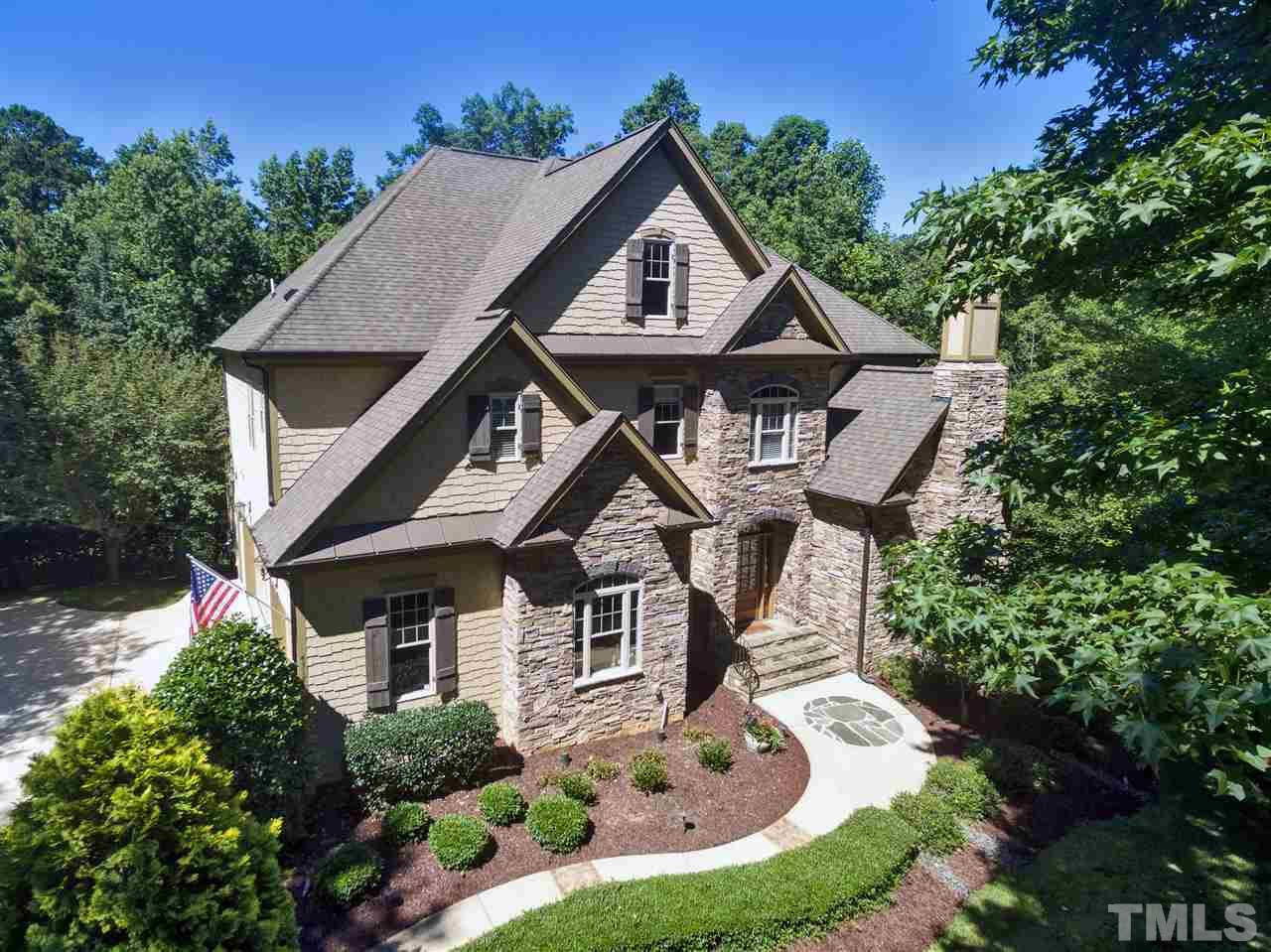 GREAT SPACE IN THIS CUSTOM BUILT TWO STORY HOME W/ FINISHED BASEMENT. Fabulous private setting on .92 ACRE wooded Cul-De-Sac Lot. Features Lrg Family Rm, Formal Living & Dining, Hardwoods, 1st Flr Bedroom, w/ bath. COOKS KITCHEN w/professional SS appl, ctr island, walkin pantry. LUXURY OWNERS SUITE w/FP & sitting area, spa like bath.  BASEMENT w/2nd kitchen, Game RM, Exercise RM & Theater RM. OUTDOOR LIVING area w/ patio & stone FP,observe wildlife & nature. 900 Sq Ft 3RD Floor Walk UP Attic.3 CAR GARAGE.