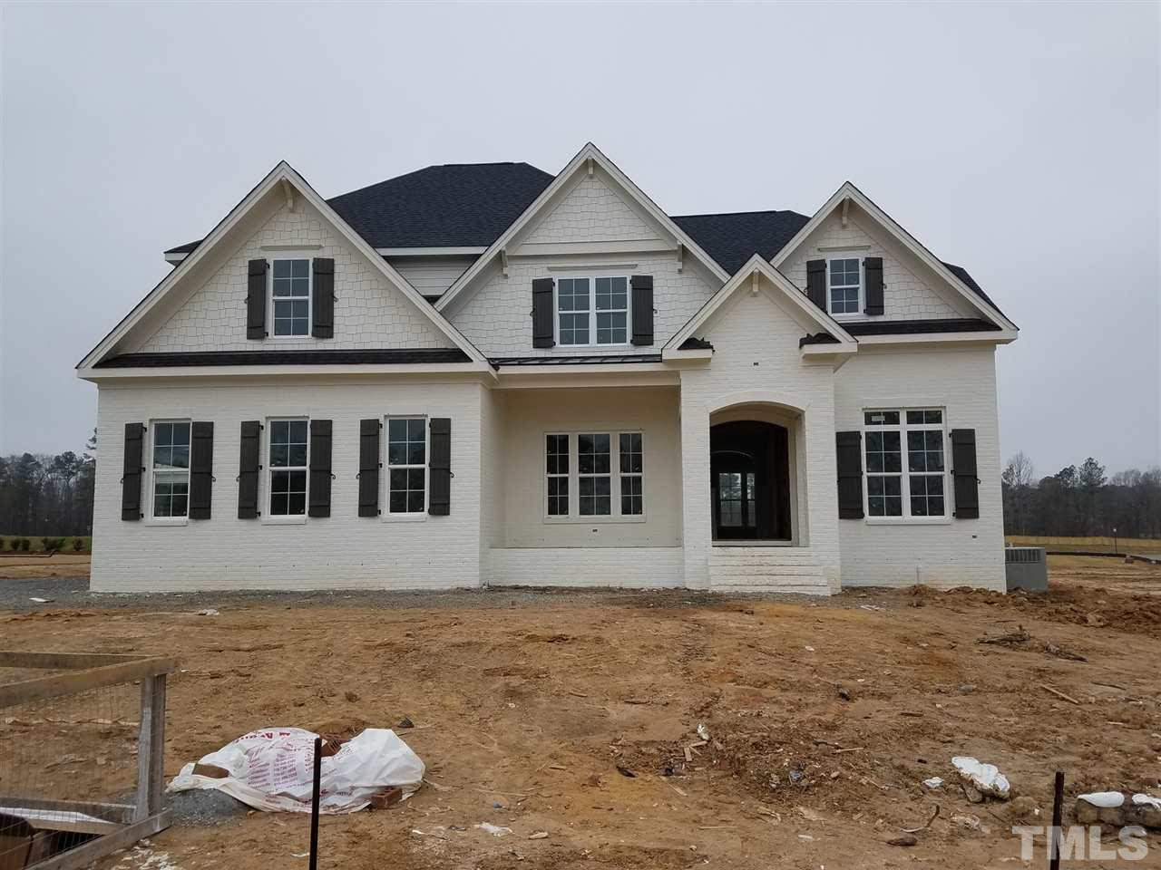 Beautiful custom built home by Future Homes by Jim Thompson.  Custom trim work throughout, custom closets.  Grand foyer opens into large family/kitchen/breakfast area.  Family room has coffered ceilings and built in shelves beside fireplace.  Large center island in gourmet kit with upgrade appliances.  Large walk in pantry.  Owner's suite is huge with tray ceilings and a closet to die for.  Closet has direct access to laundry.  4 other bedrooms each with a bathroom.  Large playroom and walk up attic.