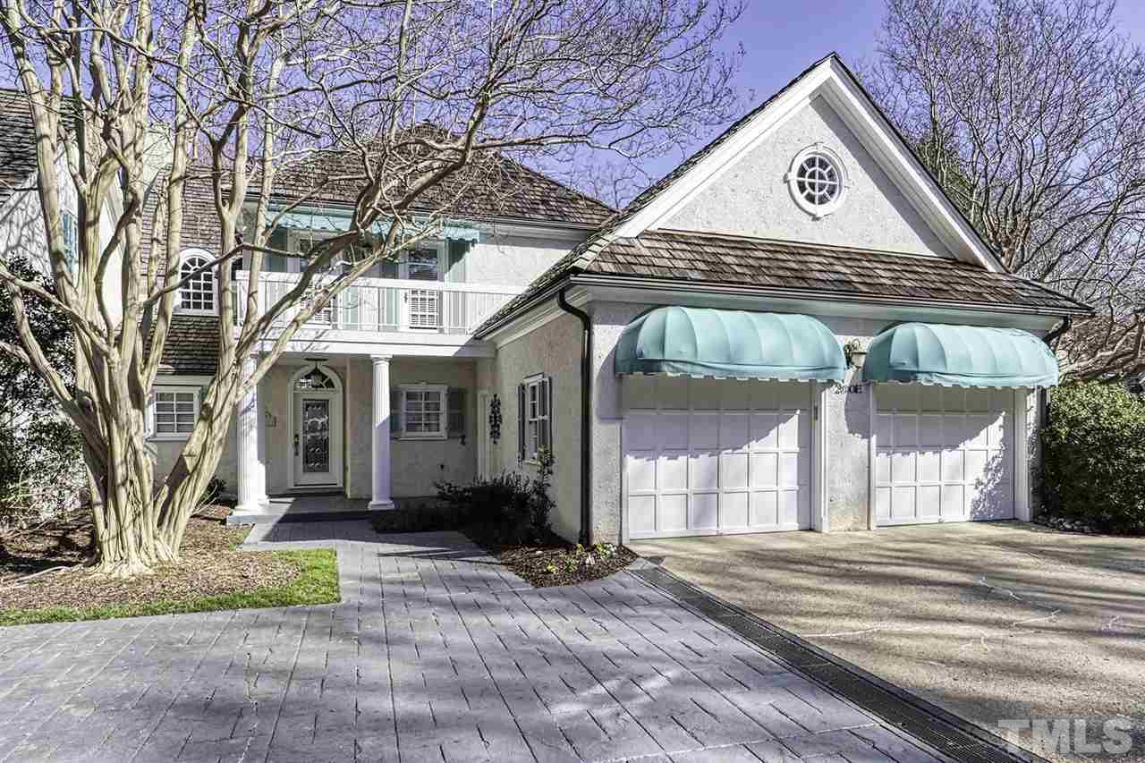 Fabulous 4 bdrm home overlooking MacGregor Down Lake, Country Club, & Golf Course. 2 story fam rm features a custom gas log frpl & wall of windows w/gorgeous view of lake. 1st flr mstr w/tons of built-ins, WIC, private whirlpool bath & access to covered patio. Spacious kit w/plenty of cabs, granite counters, island & SS appl's. Lrg bonus rm, loft area. Full bsmt has fam rm w/frpl, home theatre rm, wet bar, built-ins, bdrm & full bath. Convenient to US 64, US1, Wake Med, shopping & dining