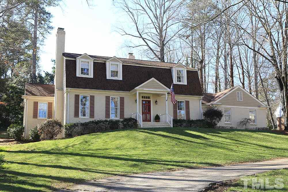 Gorgeous Country Club Hills House .59 acre wooded lot w/ tree house.  Lg. 40 x 13 patio overlooking lg backyard.  Across the street from Raleigh green way trail.  Wonderful floor plan (see attached virtual floor plan). 1st floor: kitchen, formal dining, living rm w/ fireplace, family rm w/ fireplace, & 1st floor bdrm/office full bathroom. 2nd floor 3 lg bedrooms & 2 full bathrooms. 2 car carport. Dont miss the workshop w/ 10' ceilings (access on left side of house outside entrance).