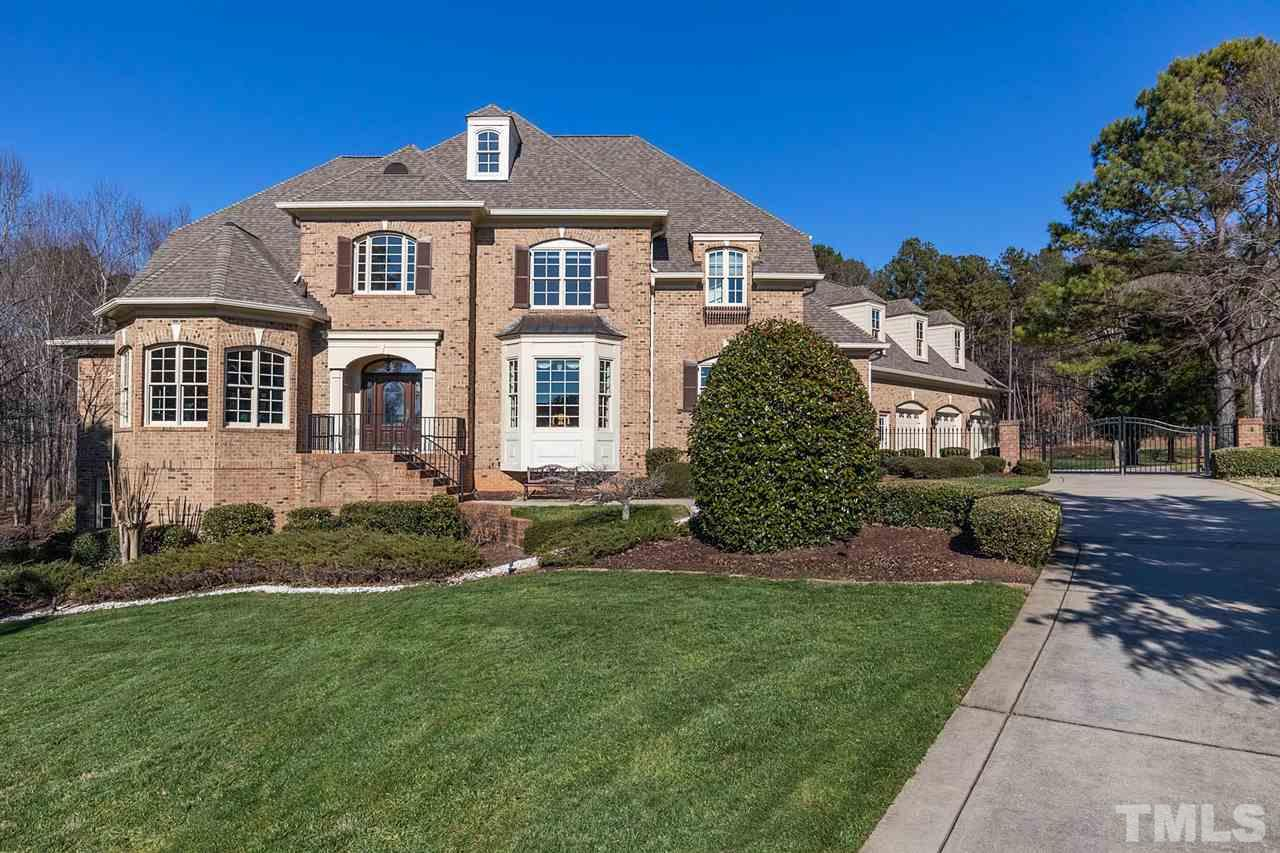 Grand 2-story foyer flanked by library rm w/built-in bkshelves & formal DR w/attached Butler's Pntry.Epicurean Kit w/rich granite ctps & cabinetry. Ctr Island, top of line apps & brkfst bar.Owners retreat w/beautiful views, luxurious spa bath w/jetted tub, walk in shower, dual vanities & WIC. Spacious 2nd flr: 4 Bdrms, 3 full Baths, Bnus Rm & private Office space.Full daylight bsmnt w Kit,Theater, Game Rm, Rec Rm, Exercise Rm, Bar, 2nd Mstr Bdrm, Wine Tasting Rm. 3 Car Grg. Pool & Jacuzzi! Almost 2 acres!