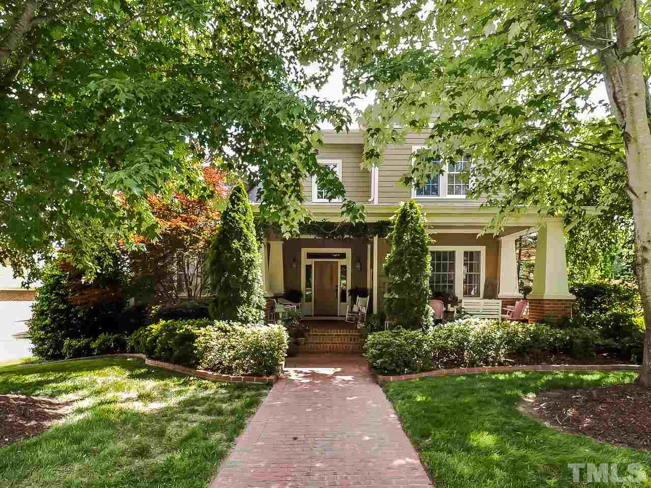 Gorgeous Craftsman Inspired Estate Finished in the Richest Details.Wrap around brick porch.2 sty entry.12 ft ceilings on 1st flr.HDWD thru out! No detail was spared! Gas logs in FR w/custom built ins.KIT w/miles of granite, gorgeous cabs.BFT nook w/pvt porch.3 seasons rm w/FP.1st flr MSTR boasts picture frame molding,spa bath&over sized custom walk in. Pvt stairs lead to en suite perfect for multi-gen living or 2nd BONUS.Amazing patio&hardscaping.New roof, ext&int paint. Close to RTP,540,55.Top Schools!