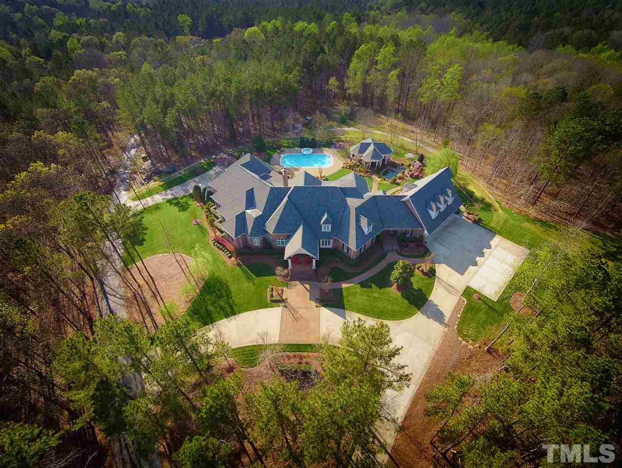 Sprawling 31 Acre Estate Home Located On Wake / Durham Cty Line. This Exceptional Property is Just Minutes from Falls Lake w/ Easy Access to Raleigh &  Durham. This Custom 5 BR, 7 BA Home Offers Amenities including An Open Floor Plan, Stunning Living Room, Huge Chef's Kitchen, 1st Floor Master Wing w/  Office, Exercise Room, Study & His / Hers Walk In Closets. A 4 Car Garage w/ Bathroom, Outdoor Loggia Overlooks Pool & Custom Waterfall w/ Koi Pond.  Landscaped & Sits On 31+/- Acres Of Privacy!
