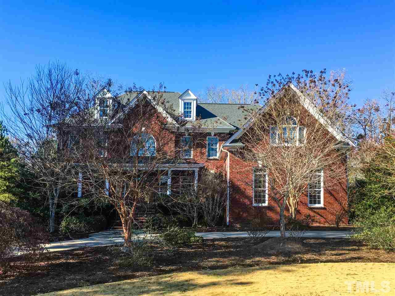 Come see Sat. 4/6, 1-4! Custom 5023+2302 sq.ft home with circle drive leading to double staircase & 2 balconies overlooking. Vast master suite, 5 beds all ensuite & loft up. Kitchen has endless granite counters & cabinets & large island overlooking wooded yard. High ceilings & crown molding throughout. 1st floor in-ceiling audio. Walkout  basement w/ plumbing, electric & fireplace-ready to finish. Home Warranty! Chatham Low Taxes! Community pool, tennis, trails. Seller to pay $10,000 buyer closing costs!