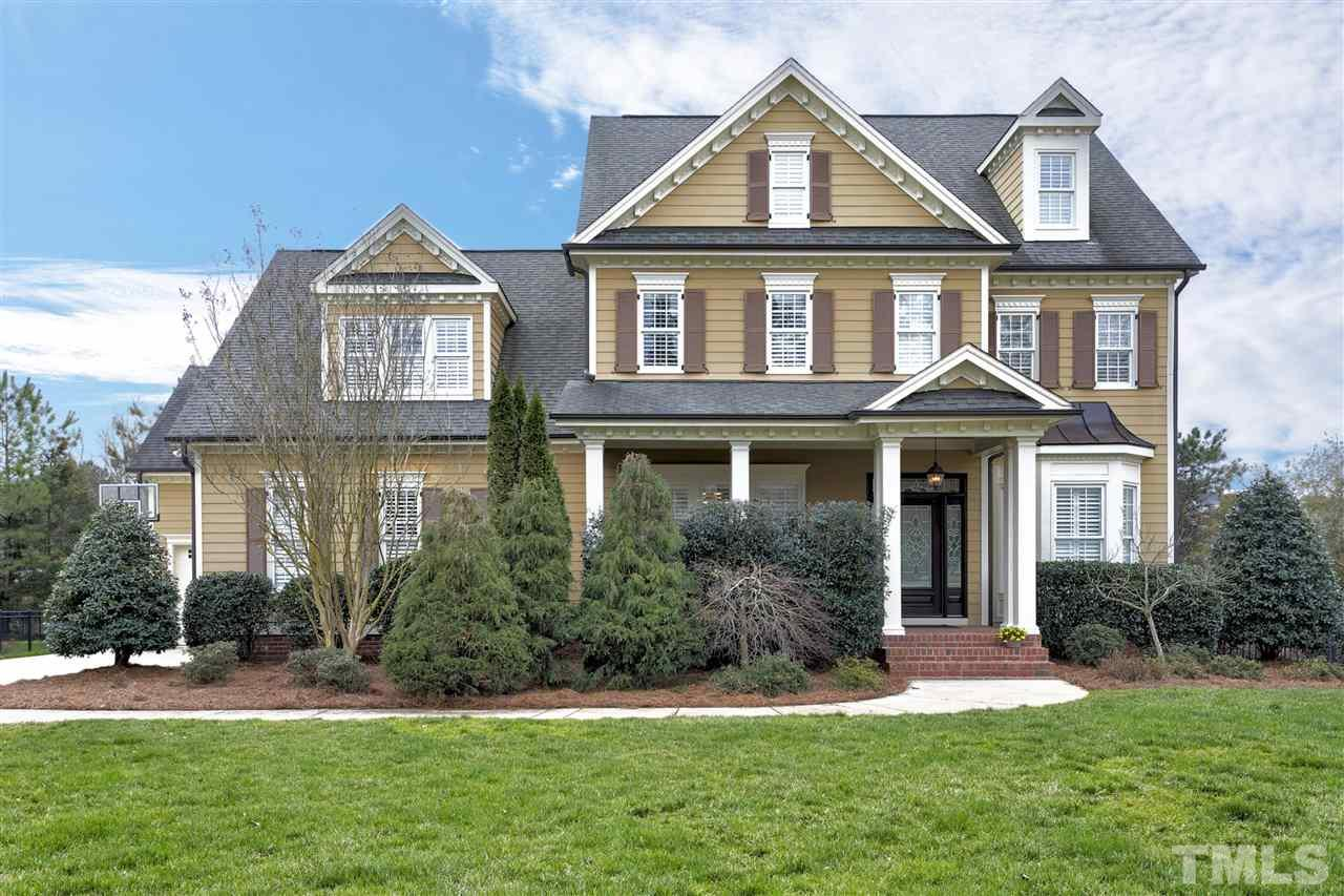 Neighborhood-CHECK; Location-CHECK; Amenities-CHECK; Water View-CHECK.  EVERY BOX IS CHECKED.  This one has it all.  Carolinian built totally custom home on cul-de-sac.  6 bedrooms; 5 1/2 baths with amazing lake view. First floor guest suite, site finished hardwoods, built-ins; tin ceiling in dining room; custom molding; granite, custom cabinets, first floor office.  Huge secondary bedrooms, private backyard, fully fenced; 3 car garage... the list goes on! Schedule your visit now to see this lovely home.