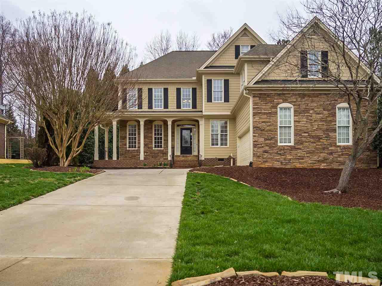 Built in 2003, this Holly Springs two-story cul-de-sac home offers a loft, hardwood flooring, a fireplace, and a two-car garage. This home is part of the Wescott Community Association, Inc.