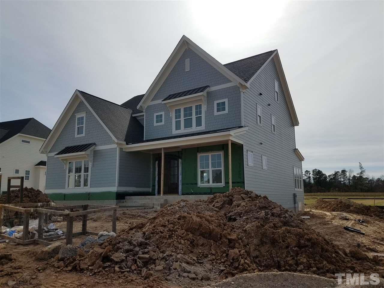 Custom built home by Future Homes by Jim Thompson. Double entry doors open to large foyer which leads to open family/Kit/breakfast area.  Custom trim work through out home. Coffered ceilings in family. Tray ceiling in owners suite with spa bath with free standing tub and shower with 3 different spray options. Owners closet opens into laundry. 2 bonus rooms, one on 2nd floor one on the 3rd. 5th bedroom and full bath on 3rd floor.  Custom cubbies in mud room.  Cabinets to ceiling in kitchen.