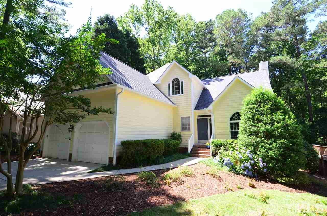 Gorgeous Lochmere home backing to walking trails connected to one of Lochmere's most desirable lakes. A generous first floor master suite features updated countertops, new fixtures, lighting & large WIC. Open floor plan with abundant natural light & excellent space for dining & entertaining. Oversized rear deck designed for entertaining or enjoying the privacy of your wooded lot. The walk out lower level offers a large full bath & bedroom ensuite, bonus area & large heated/cooled workshop.