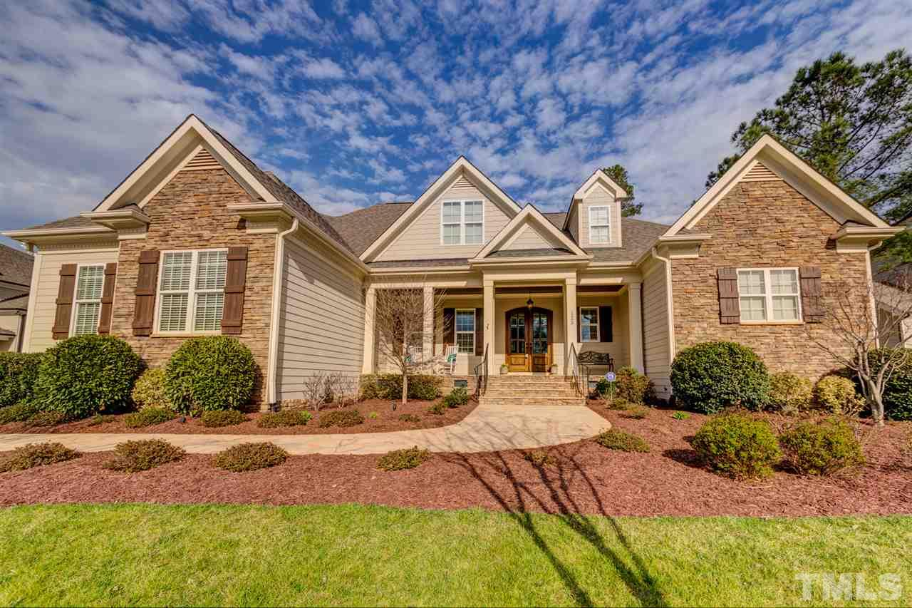 Gorgeous GOLF COURSE home w/3 BR's on the 1st floor. Master craftsmanship moldings, hardwoods, and open concept plan. Parade of Homes WINNER - Best Hearth Room.  Gorgeous gourmet kitchen w/huge pantry, pull out spice racks, gas cooking, & SS appl. 1st fl Owners Retreat w/french drs to scrn porch. Lg. Spa bathroom w/jet tub, OS shower, Lg walk-in cl w/cust shelv.  ITS home music system, Bonus room w/Wet bar, new beverage refrigerator. 3 car garage, patio, stone screen porch.  1492 attic.! Pre-Inspected.