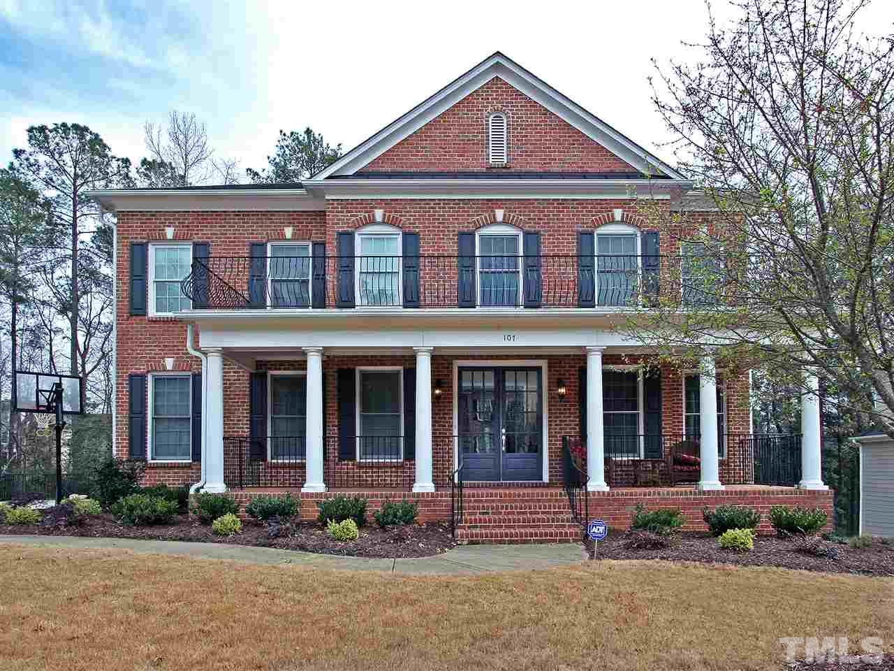 Just over the Cary line and minutes from Apex! Stately brick-front executive home with unfinished walk-out basement. Side-entry 3-car garage. Wonderful backyard with large paver patio and firepit. Backs to wooded buffer. Gourmet's dream kitchen with large island and gas cooktop. Lots of cabinet space. Open-concept floorplan. 4 Bedrooms + Large Bonus Rm. Family room has fireplace and built-ins. Hardwoods on main level and in bonus. Convenient home office with French doors. Rocking-chair-style front porch.