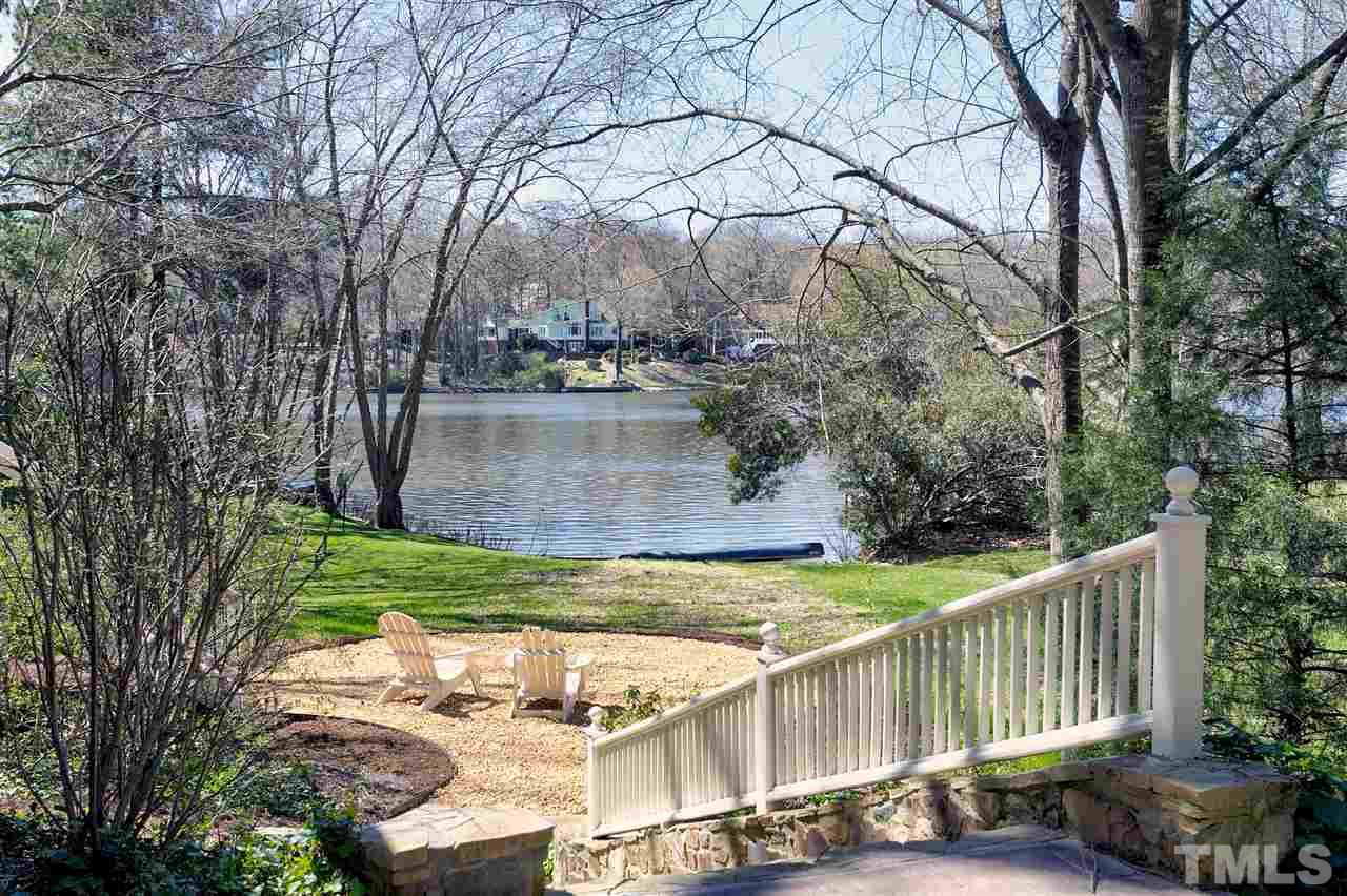 Lochmere Lake w/private dock! ALL BRICK, cul de sac, 2-story, 4 beds, 2.5 baths, meticulously maintained. Hardwds 1st flr. Freshly painted int. Kitch features: White cabinets, granite counters, large pantry. Beautiful mill work throughout. All new sliding glass  doors, with view of lake from family. Lake-view breakfast, bonus room, master bath, and upstairs office/br. Front and rear stairs, wet bar, blt in cabinets. Trails, tennis and swim amenities. Easy access to all areas of Triangle.