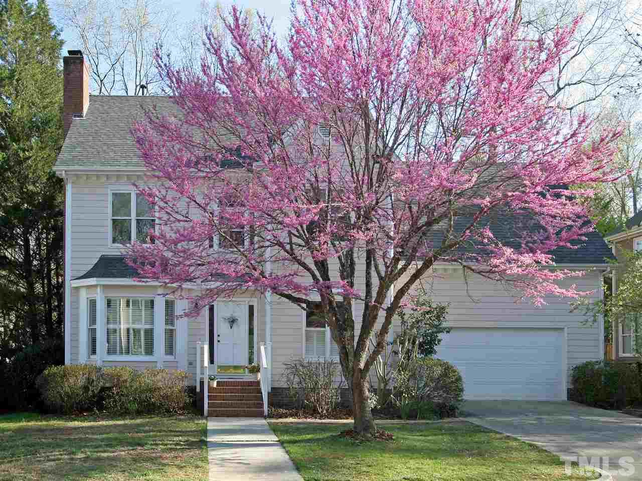 WOW! What curb appeal. Red Bud is blooming now and the Crepe Myrtles will be soon. Quiet loop street. Close to Waverly Place Shopping Center, WakeMed Cary Hospital, Lochemere Golf Club, Regency Lake, Koka Booth Amphitheatre, Whole Foods, Harris Teeter.