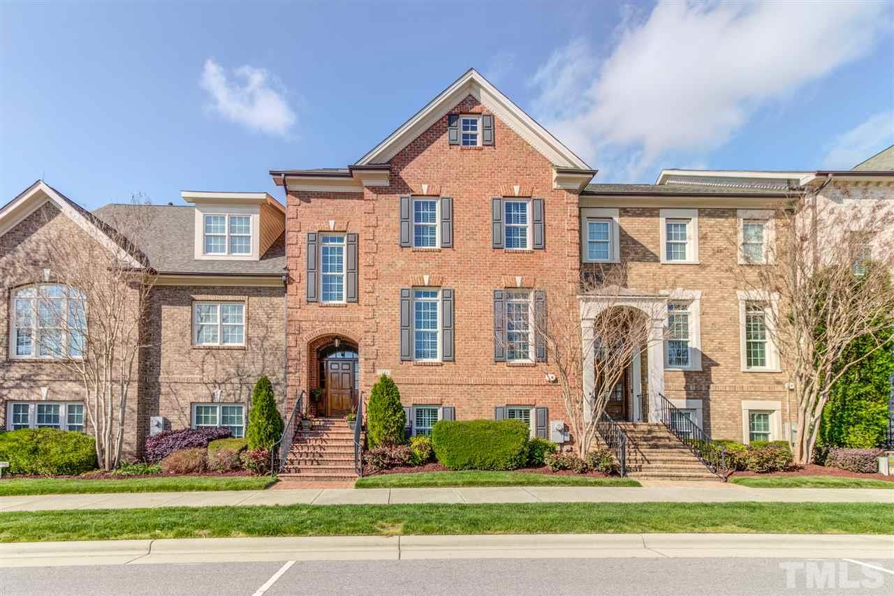 Immaculate custom Brownstone townhome in highly desired Village Square @ Amberly. 4 spacious bedrooms & 3.5 baths, 3 car garage & ELEVATOR. Extensive molding, chef's kitchen w/granite counters & high end S/S appliances, formal living & family with fireplaces & built ins, walk-up u/f attic. 4th bedroom makes ideal guest suite, bonus or media room w/private bathroom. AHS Home warranty incl. Access to Residents club, fitness center, pools, walking trails. Excellent schools & location! Shows like a model!