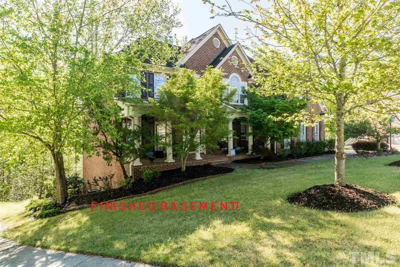 Beautiful brick home on priv wooded cul-de-sac lot in Cary Park! Dramatic wooded views from all 3 flrs! Lrg open flr plan; extra moldings & trim, hrdwds. Granite in kitchen and almost new carpet thru second level. Beautifully fin basement incl full kitchen, fr/place in gathering room, game room & more. Lux master suite w/ sep sit area and spa-like bath. Spacious secondary beds w/ en-suite baths including main level guest. Extensive outdr living spaces! Great schools! Easy access to RTP, RDU, 55, 40 & 540!