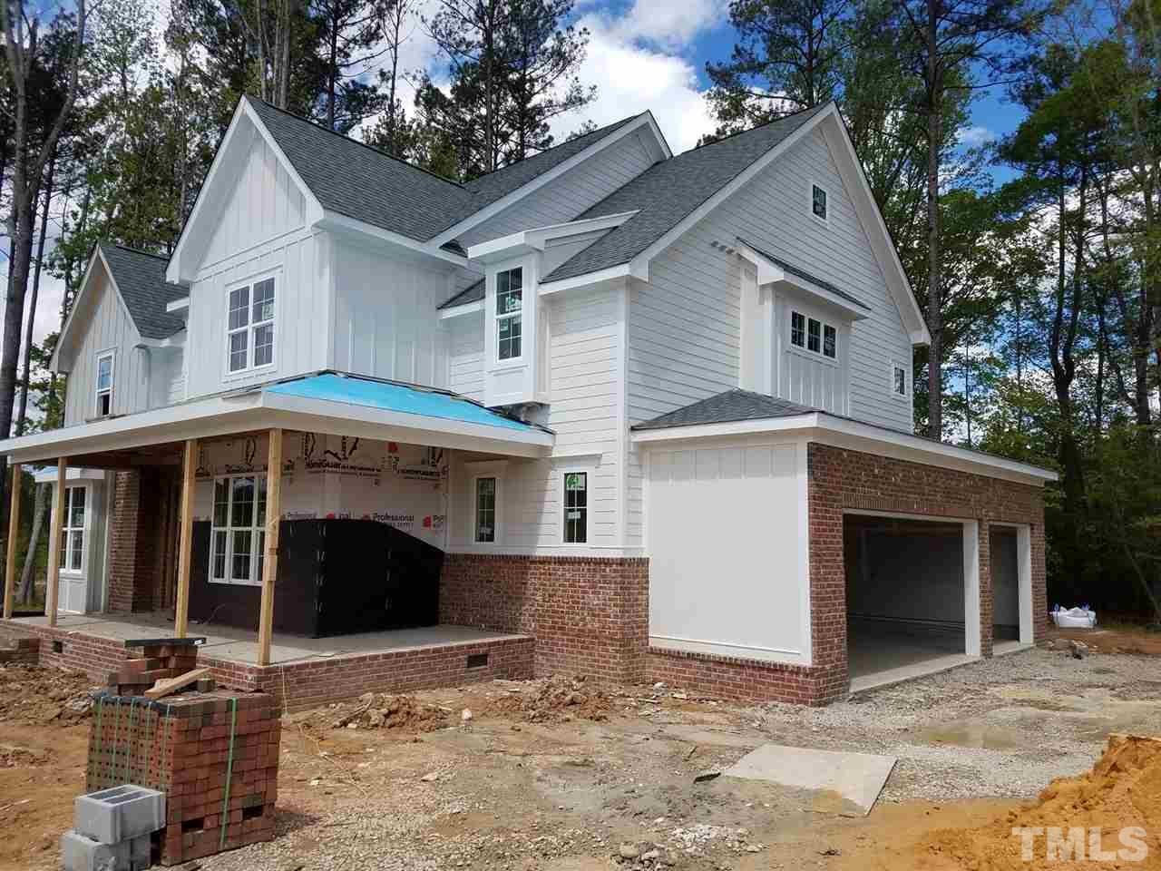 Custom built home by Gray Line Builders.  Foyer opens to dramatic stair design, Family room with Coffered ceilings, Kit open to family and breakfast area, huge center island.  Hardward first flloor, stairs, and 2nd floor hall. custom trim work throughout the home.  Owners suite with widow seat, spa bath with free standing tub Large walk in shower. Huge closet.  Every bedroom as private access to bathroom.  Two bonus rooms, one could be used for media or office. Very private rear yard. FP on Screen porch