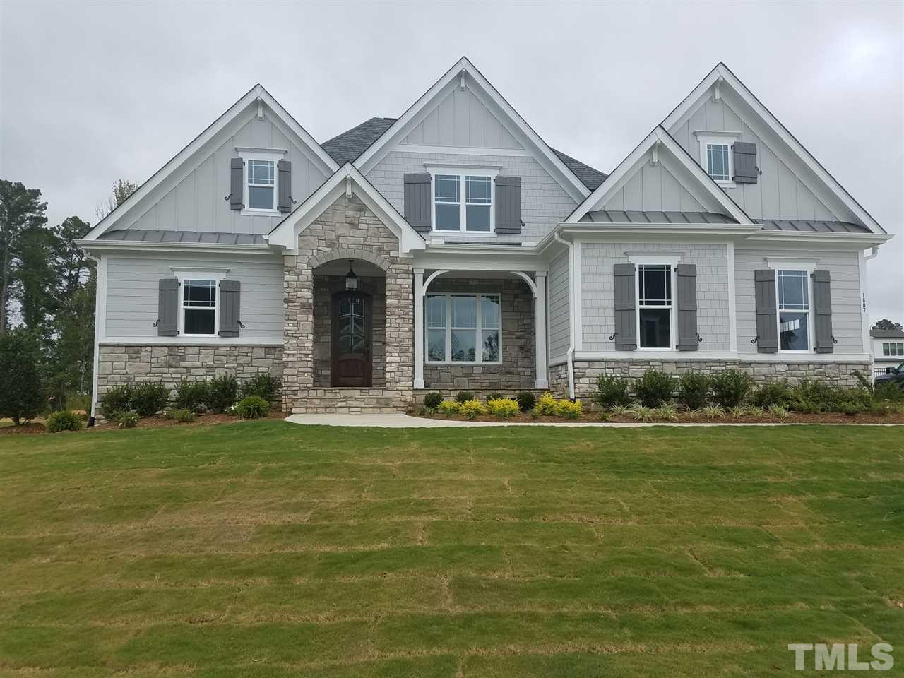 Custom built home by Gray Line Builders. 1st floor owners and guest suite. Owners has his and hers walk in closets, spa bath with free standing tub, walk in shower. foyer opens up to huge family room open to kit and breakfast area.  Kit with custom cabinets quartz counter tops and huge center island. Commercial grade appliances. 3 car garage.  2 bdrms on 2nd floor and large bonus room.  all bedrooms have private baths and walk in closets.  Screen porch has FP and opens to large level rear yard.
